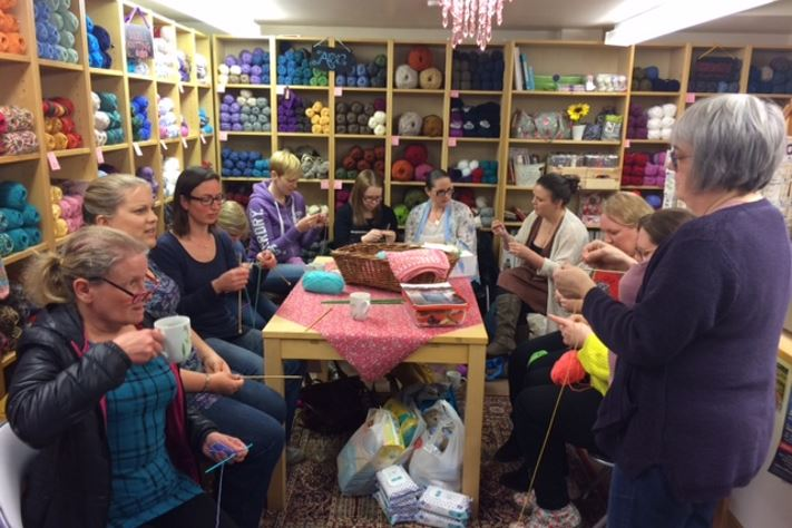 Busy knitting in the Wool Shop at Knitting Smiles Across East Lancs