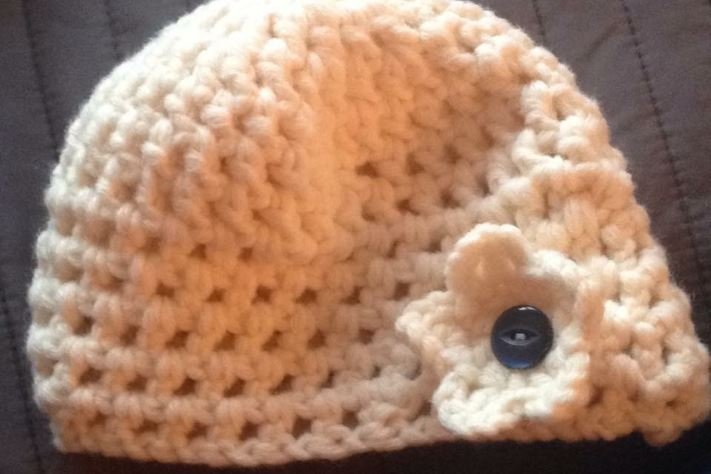 Baby hat knitted by Knitting Smiles Across East Lancs