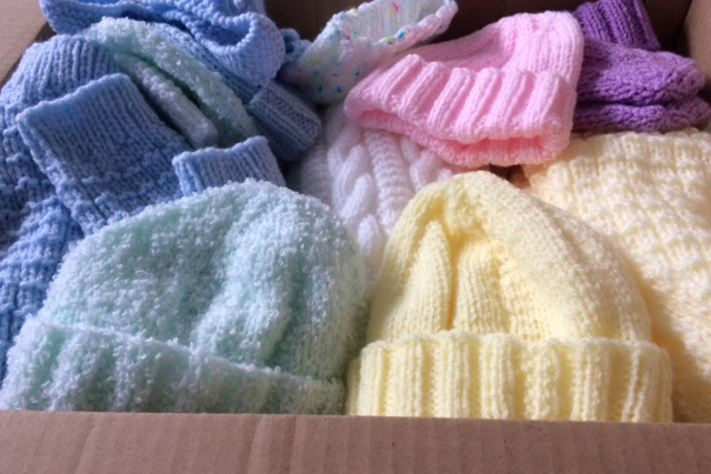 Baby hats knitted for Knitting Smiles Across East Lancs