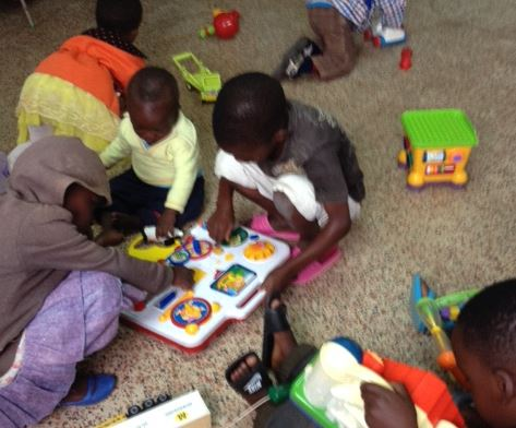 children playing with toys donated from the UK
